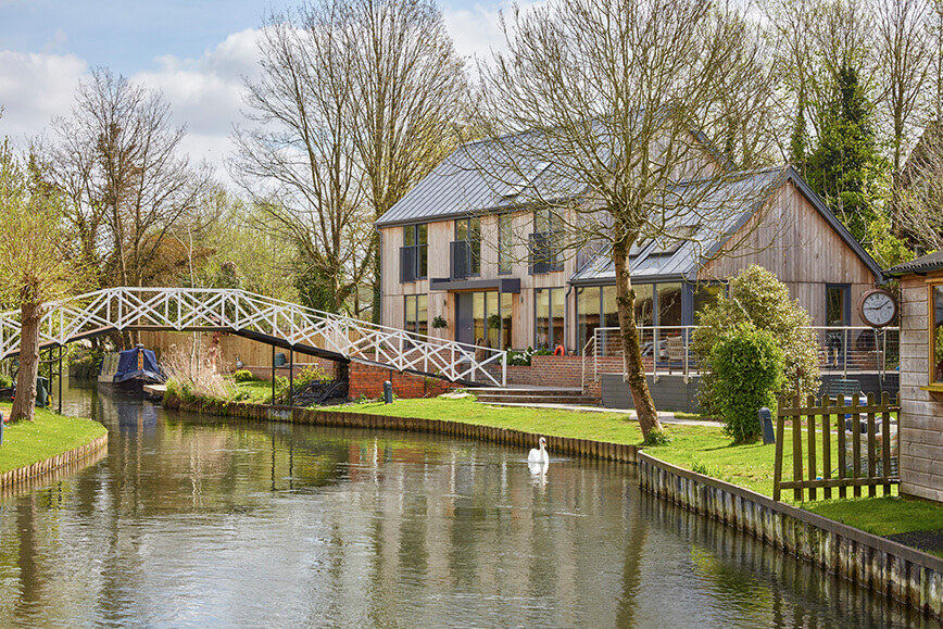 contemporary green architecture in Berkshire along canal